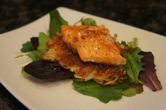 Amaretto Glazed Salmon on a Bed of Crunchy Shredded Potatoes and salad green