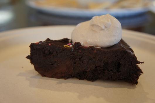 Slice of Super Fudgy Flourless Chocolate Glazed Cake
