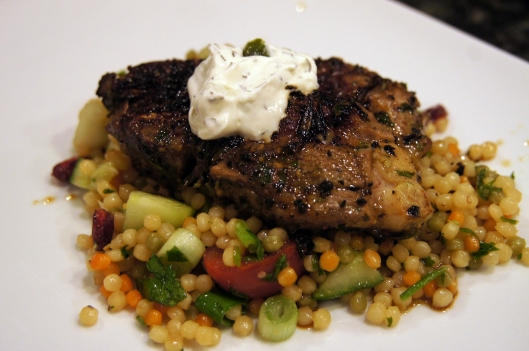 Rosemary Pan Seared Lamb Shoulder Chop served over rainbow couscous salad